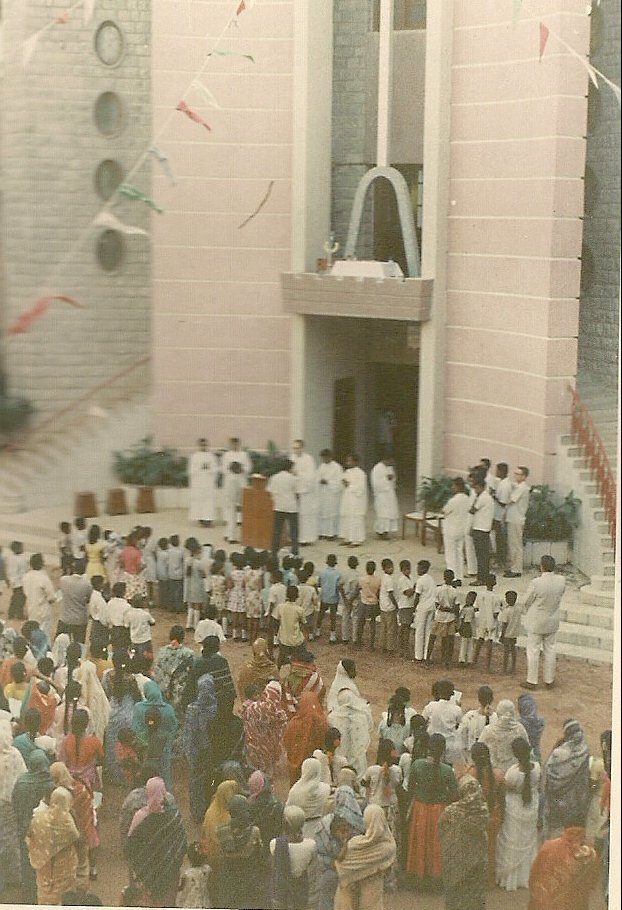 I am presiding over a function in front of the college chapel. It took place on a Sunday after mass, in 1976.