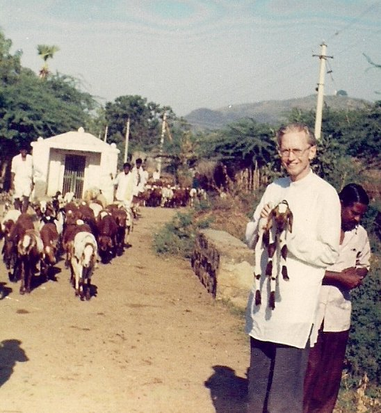 Me, holding a typical sheep from the Andhra countryside.